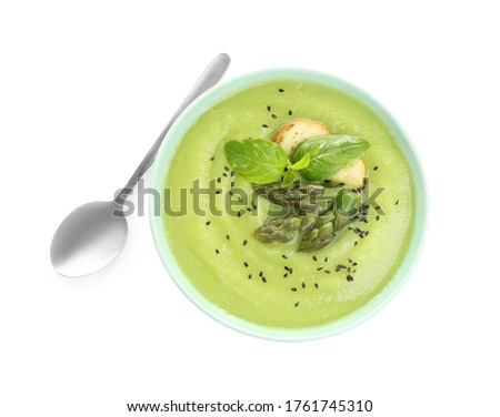 Delicious asparagus soup with basil and sesame seeds isolated on white, top view Stock photo ©
