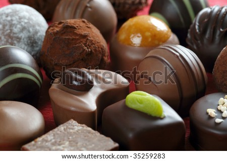 Delicious background of dark chocolates, milk chocolates, pralines and truffles.