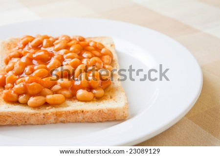 Delicious baked beans on toast on a plate