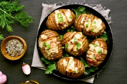 Delicious baked potatoes with bacon, green onion and cheese. Dish for dinner. Close up view. Top view, flat lay