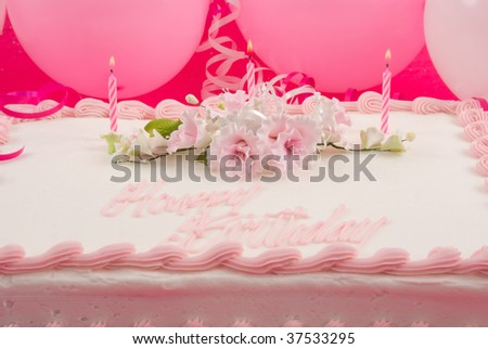 Delicious beautifully decorated birthday cake and balloons