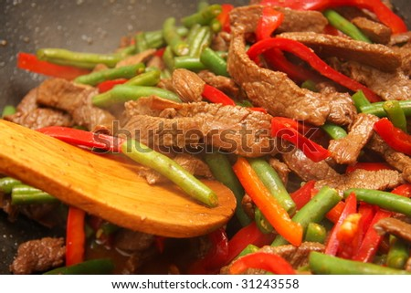 Delicious beef, capsicum, and bean stir-fry