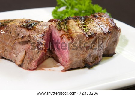 Delicious beef steak in a white dish