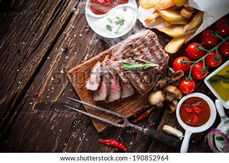 Delicious beef steak on wooden table, close-up #190852964