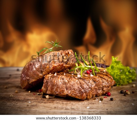 Delicious beef steakes on wood #138368333