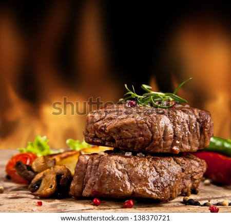 Delicious beef steakes on wood #138370721