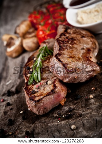 Delicious beef steaks on wood #120276208