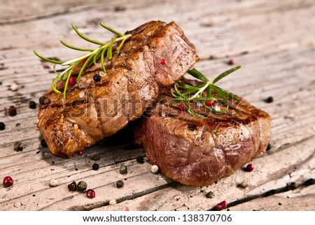 Delicious beef steaks on wood #138370706