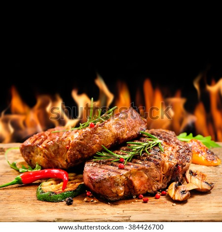 Delicious beef steaks on wood