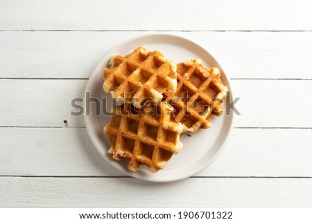 Delicious belgian waffles white wooden rustic background, top view. Stock fotó ©