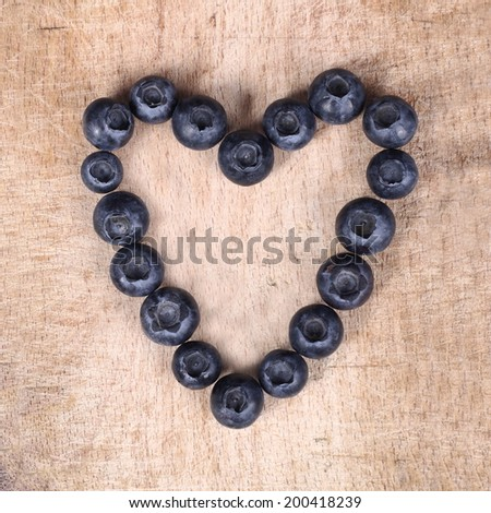 Delicious berries on a wooden board