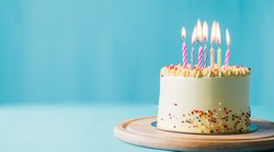 Delicious birthday cake with candle on light blue background.panoramic cover or banner concept.