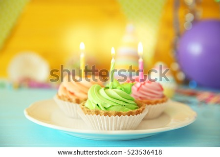 Delicious birthday cakes with candles on festive background, closeup