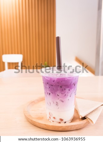 Delicious blueberry milk on wood table and blur background in summer. #1063936955