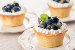Delicious Blueberry tartlets with cheese cream