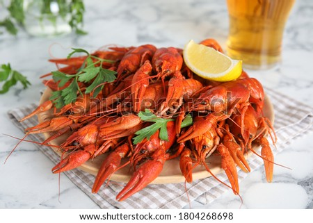 Delicious boiled crayfishes on white marble table, closeup ストックフォト ©