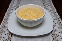 Delicious bowl of grits and butter
