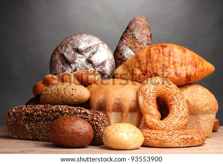 delicious bread on wooden table on gray background