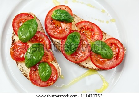 Delicious bread  with tomato and basil and olive oil