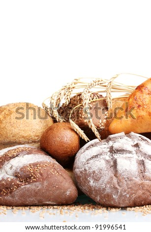 delicious breads and wheat isolated on white