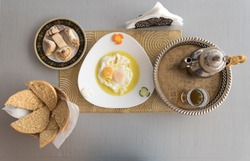 Delicious breakfast in Moroccan style served in riad (traditional Moroccan hotel)