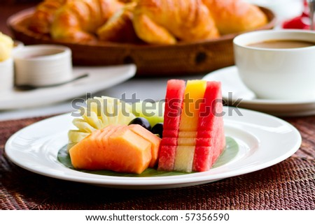 Delicious breakfast with fresh fruits, fresh bread selection and coffee