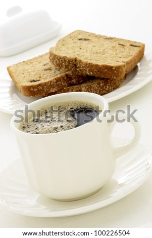 delicious breakfast with fresh hot coffee, butter and whole grain bread.