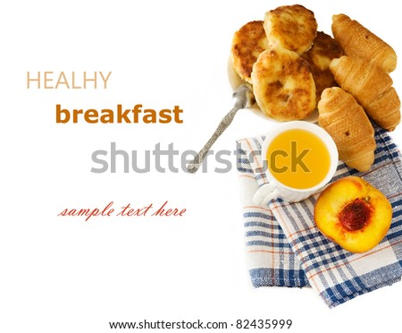 Delicious breakfast with fresh juice, fresh croissants, cheese-cake and peach with sample text