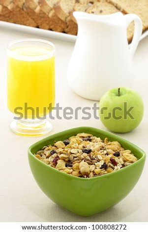 delicious breakfast with whole grain bread,fresh green apple and a healthy bowl of cereal.