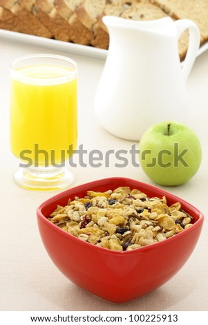 delicious breakfast with whole grain bread,fresh green apple and a healthy bowl of muesli cereal.