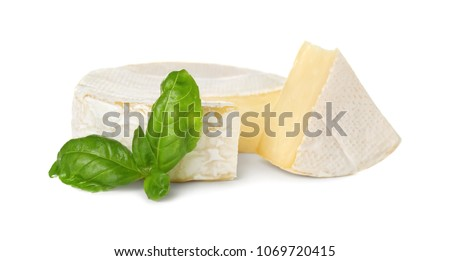 Delicious brie cheese with basil on white background Сток-фото ©