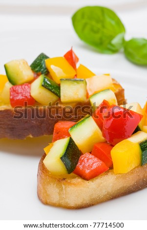 Delicious bruschetta from grilled zucchini and bell pepper on toasted bread