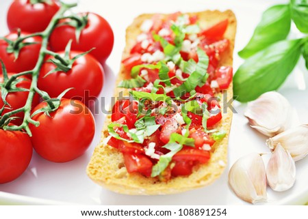 delicious bruschetta with tomato garlic and basil - food and drink
