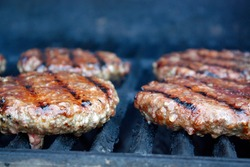 Delicious burgers sizzling on a grill
