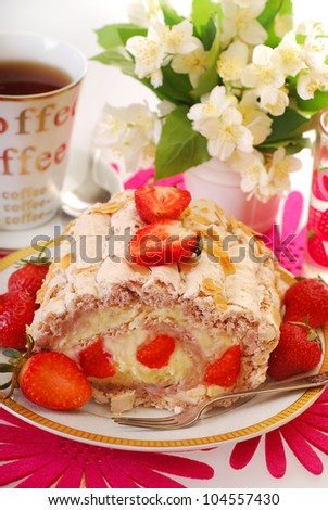 delicious cake-meringue swiss roll with whipped cream,fresh strawberry and almonds