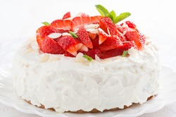 delicious cake with whipped cream and fresh strawberries, close-up