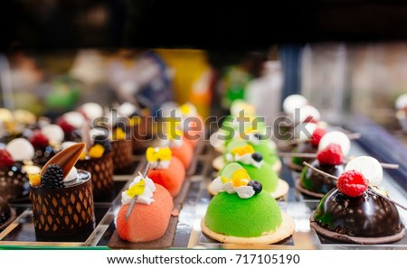 Delicious cakes on display in a confectionery shop