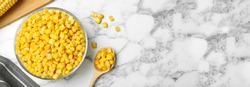 Delicious canned corn in bowl and space for text on marble table, flat lay. Banner design