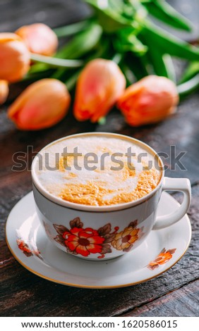 Delicious Cappuccino on Rustic Background