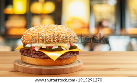 Delicious Cheese Beef Burger consists of Bun Bread, Patty, Pickle, Onion, Mayonaisse, Ketchup and Cheddar Cheese in a yellow background, with interactive 3D text for Modern Fast Food Restaurant