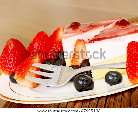 Delicious cheese cake served with fresh fruit and blueberries