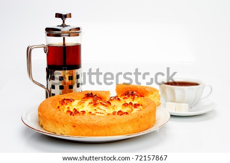 Delicious cheese pie with cut a piece of cake and black tea