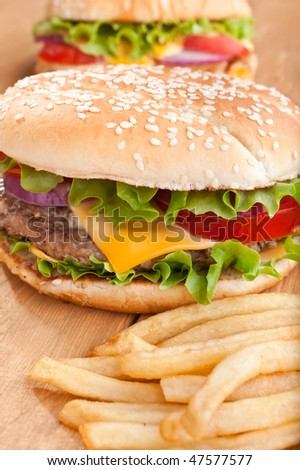 delicious cheeseburgers with french fries