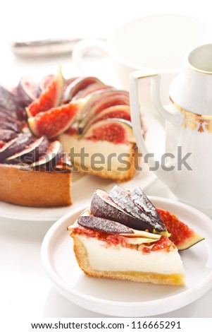 Delicious cheesecake with fresh figs on a white.
