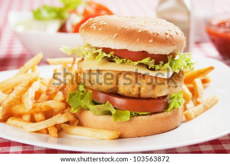 Delicious chicken burger with cheese, tomato and lettuce