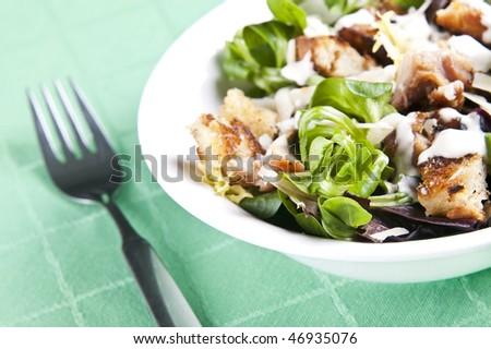 Delicious chicken caesar salad with tasty dressing