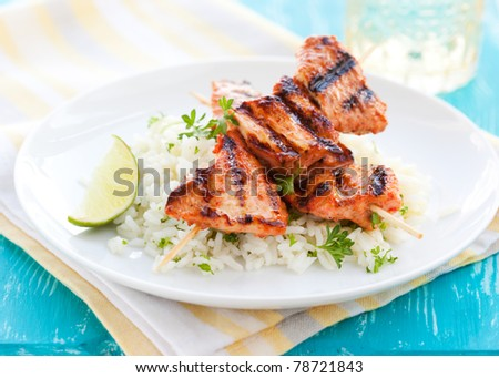 Delicious chicken masala skewers with rice