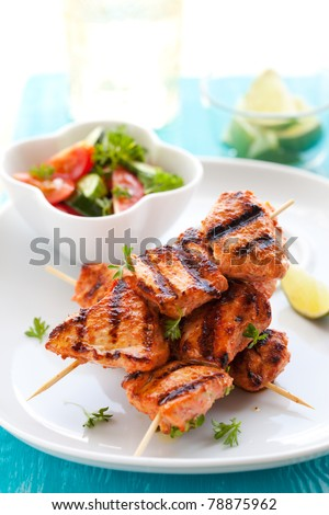 Delicious chicken masala skewers with vegetable salad.