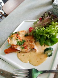 Delicious Chicken Scallopine at the western restaurant in Putrajaya, Malaysia. Putrajaya also is one of the tourist attraction in Malaysia
