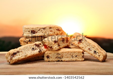 Delicious choc chip rusks against an idyllic sunrise. Stock photo ©